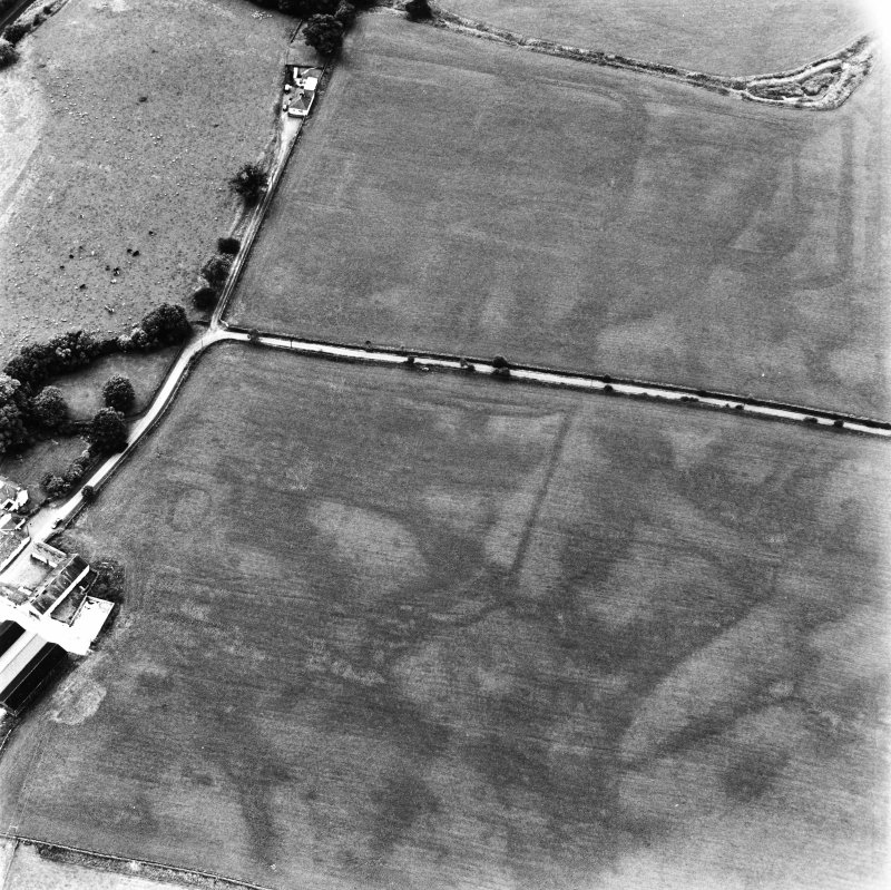 Bankhead, Dalswinton, oblique aerial view, taken from the ESE, centred on the cropmarks of Roman Forts and an oval enclosure.