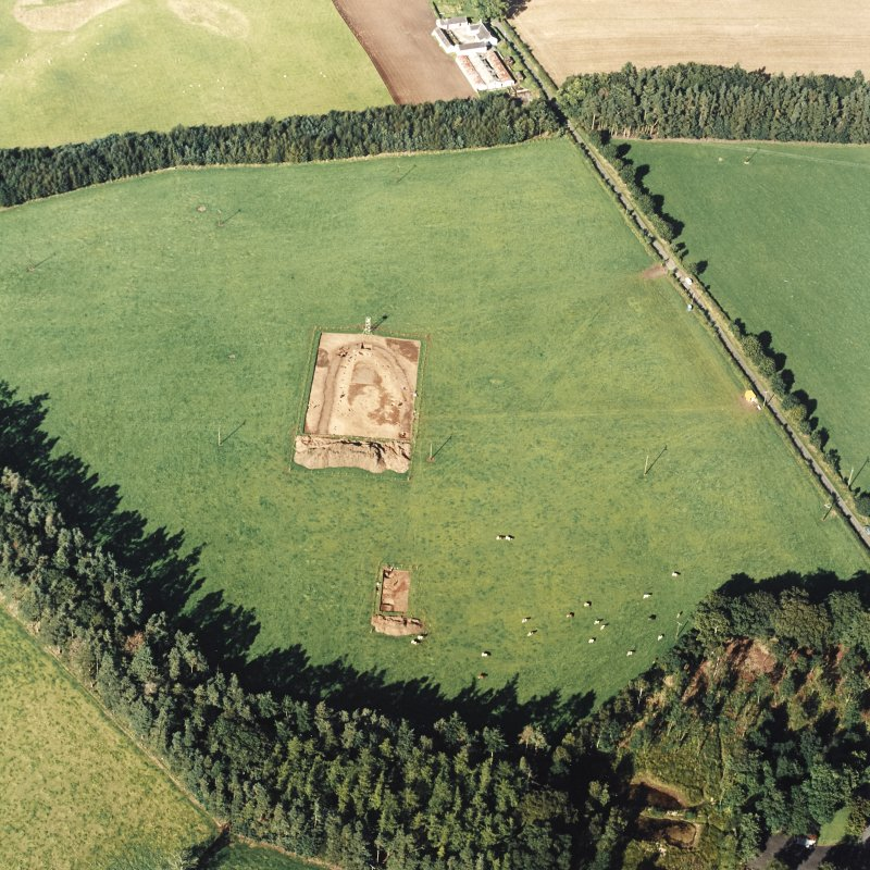 Oblique aerial view of Holywood centred on the excavation of a cursus, taken from the SSW.