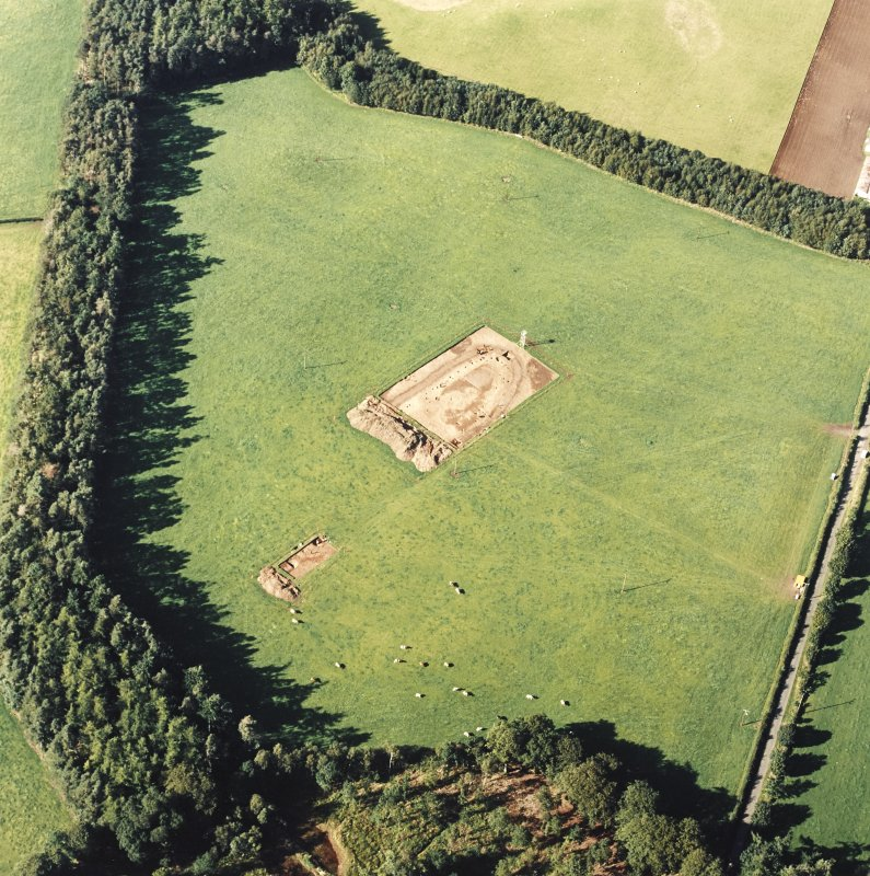 Oblique aerial view of Holywood centred on the excavation of a cursus, taken from the SE.