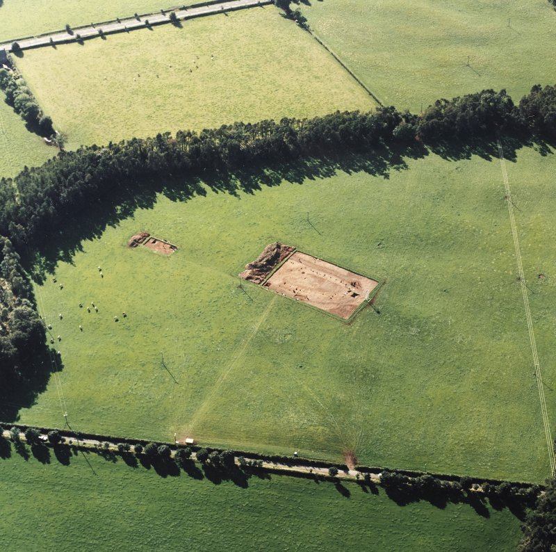 Oblique aerial view of Holywood centred on the excavation of a cursus, taken from the E.