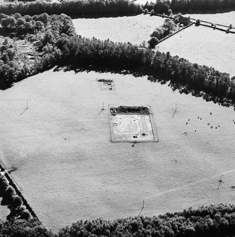 Oblique aerial view of Holywood centred on the excavation of a cursus, taken from the NE.