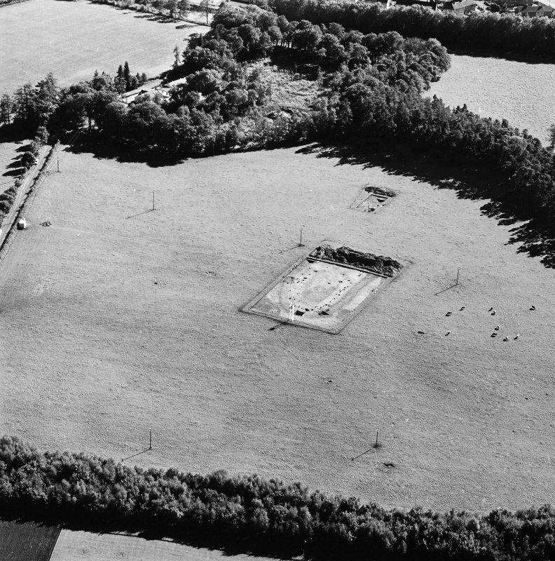 Oblique aerial view of Holywood centred on the excavation of a cursus, taken from the N.