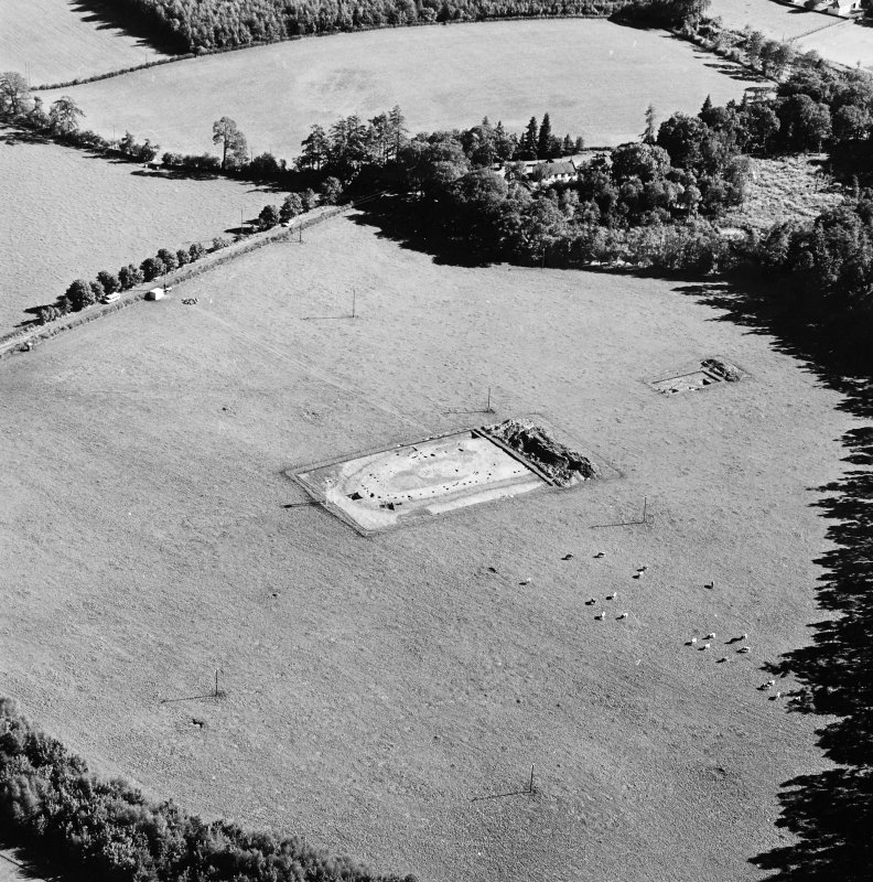 Oblique aerial view of Holywood centred on the excavation of a cursus, taken from the NW.