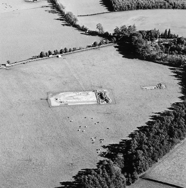 Oblique aerial view of Holywood centred on the excavation of a cursus, taken from the WNW.