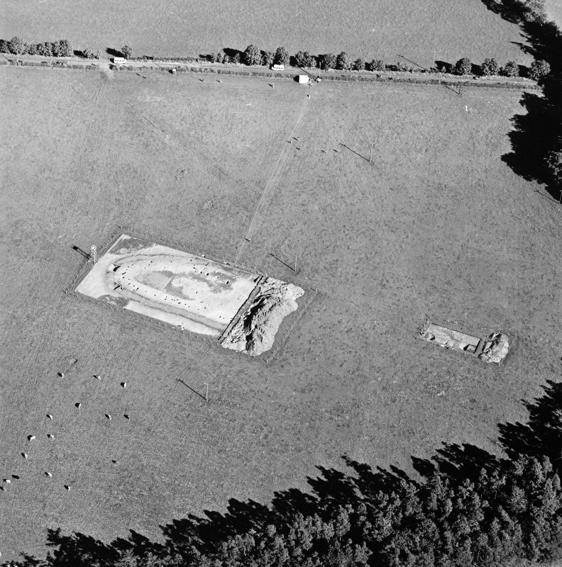 Oblique aerial view of Holywood centred on the excavation of a cursus, taken from the W.