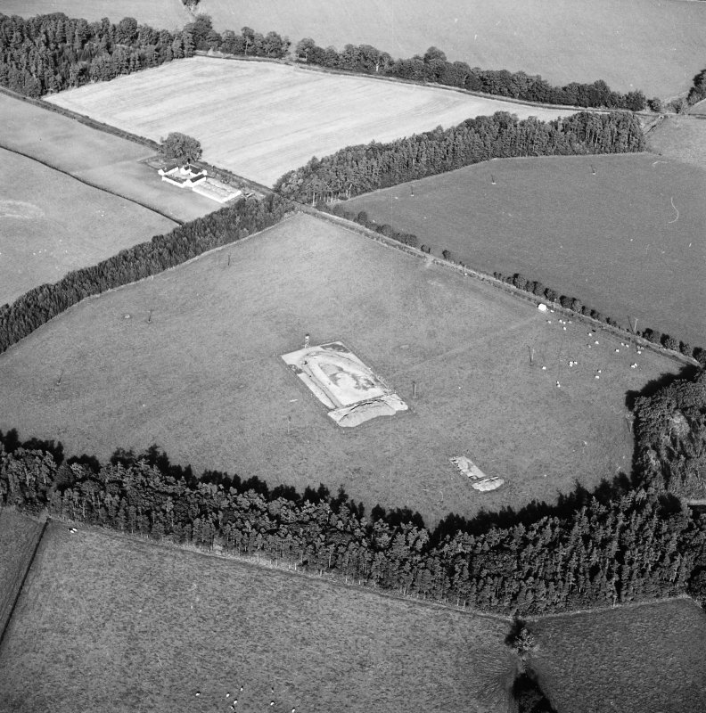 Oblique aerial view of Holywood centred on the excavation of a cursus, taken from the SW.
