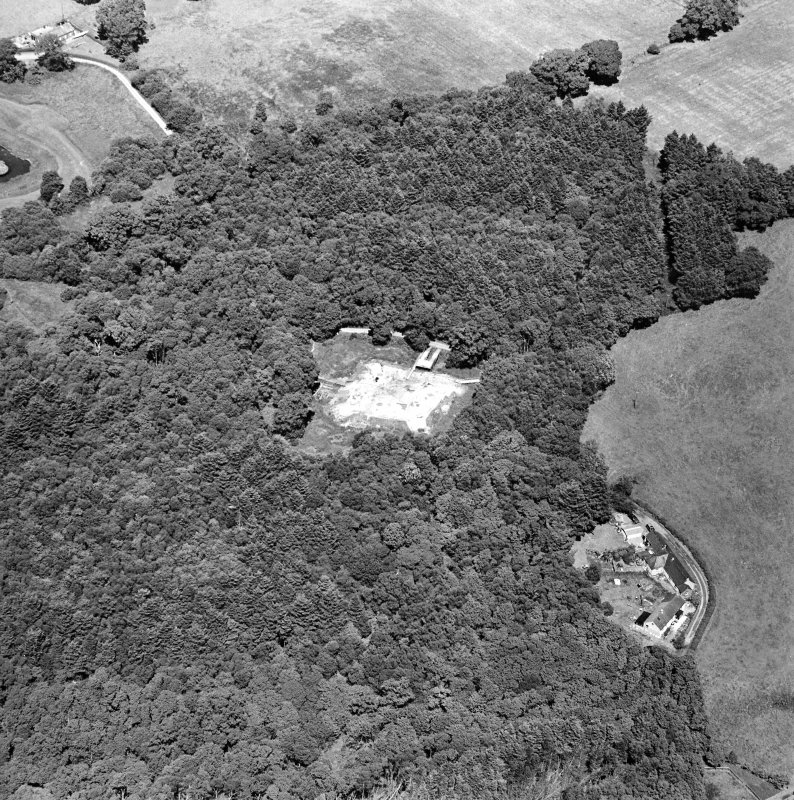 Oblique aerial view centred on the excavation of the old castle, taken from the SW.