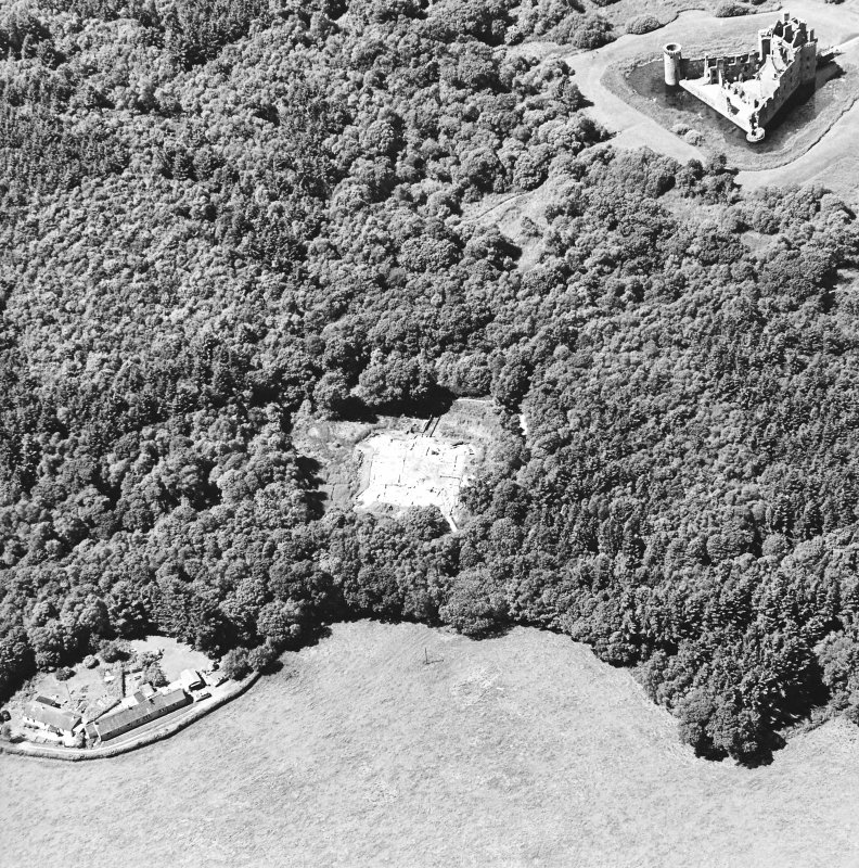 Oblique aerial view centred on the excavation of the old castle with castle adjacent, taken from the ESE.