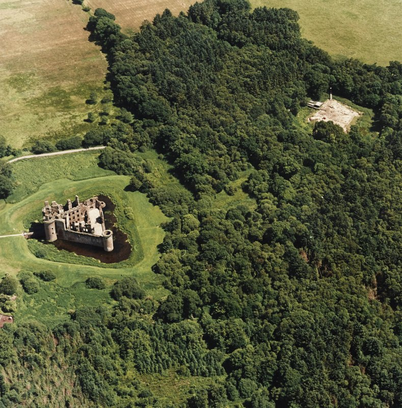 Oblique aerial view centred on the remains of the castle and excavation of the old castle, taken from the W.