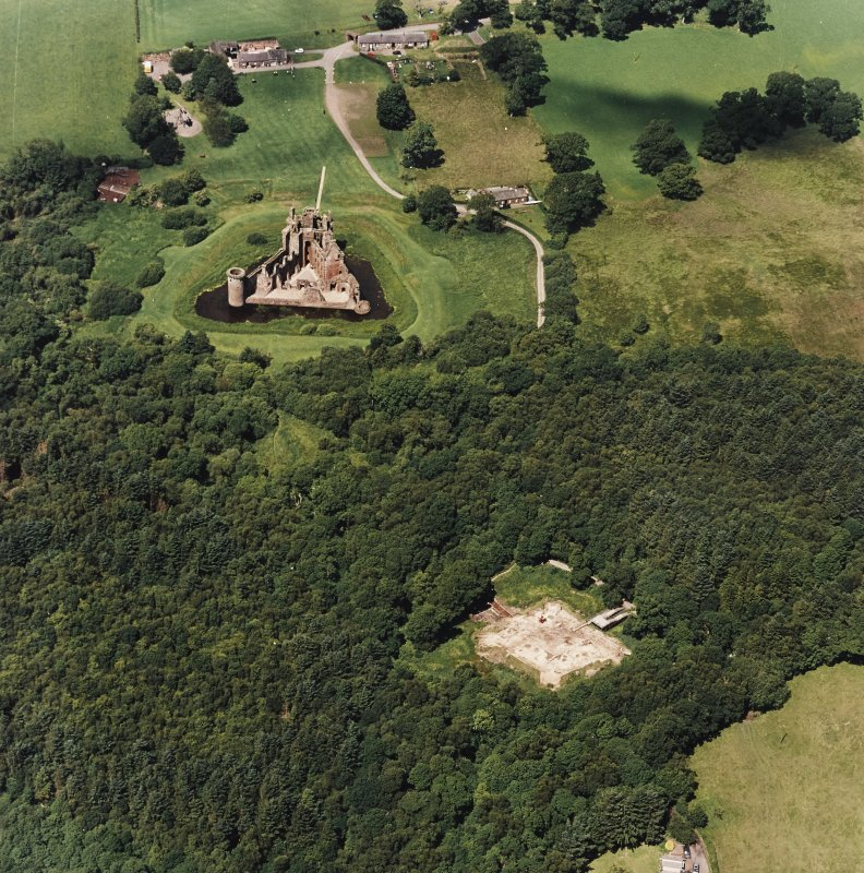 Oblique aerial view centred on the excavation of the old castle with castle adjacent, taken from the SE.