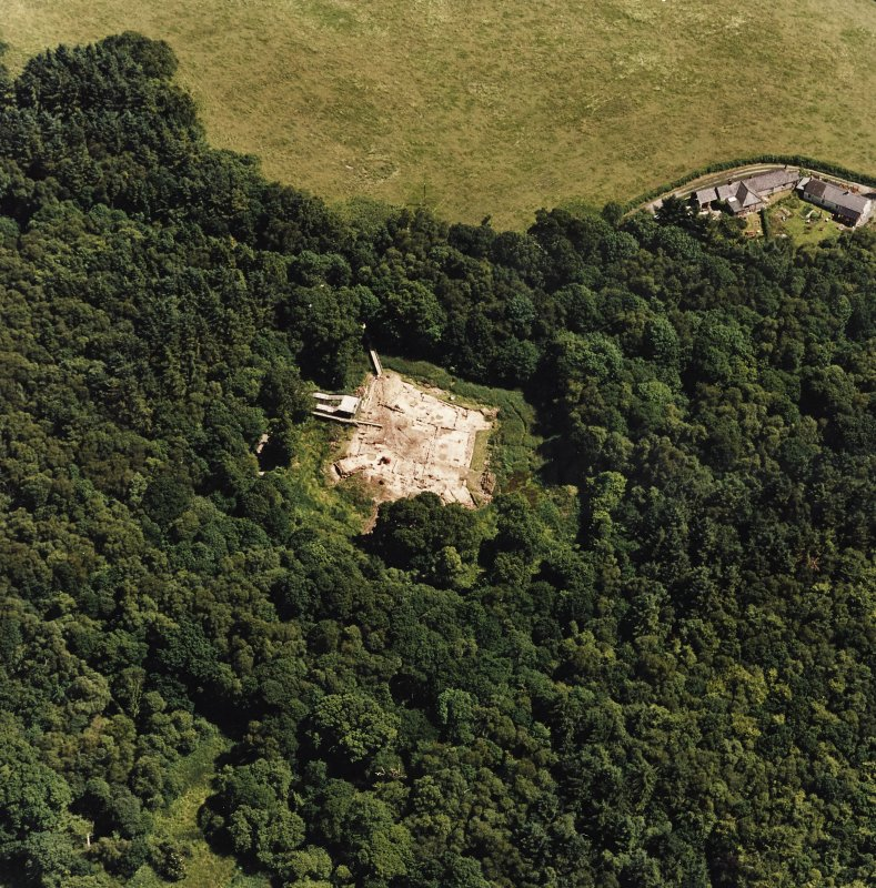 Oblique aerial view centred on the excavation of the old castle, taken from the WNW.
