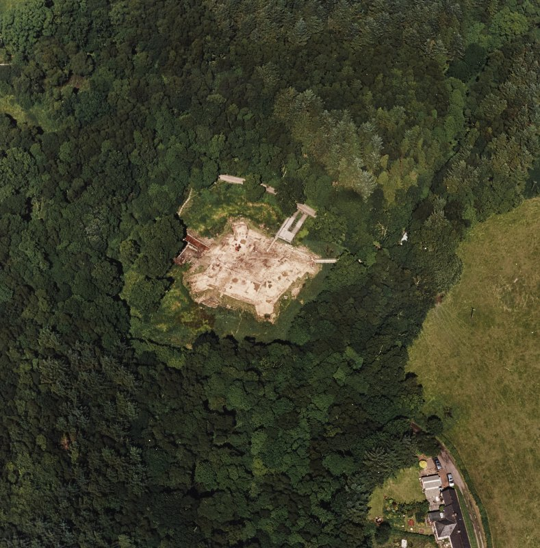 Oblique aerial view centred on the excavation of the old castle, taken from the S.