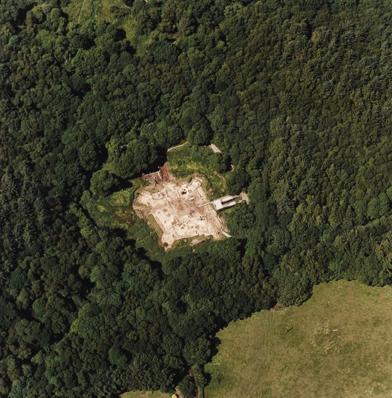 Oblique aerial view centred on the excavation of the old castle, taken from the SE.