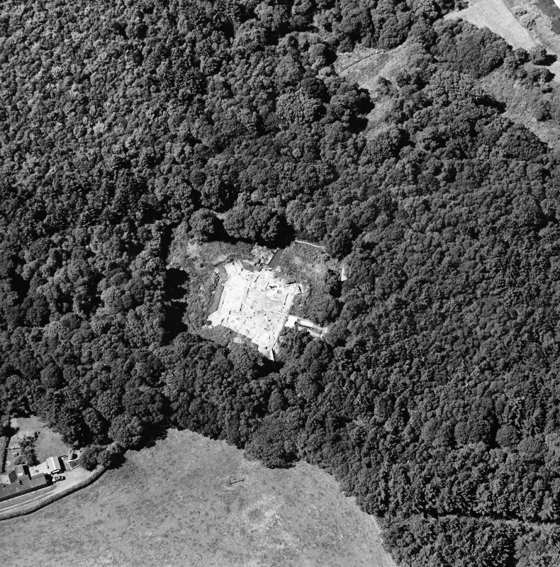 Oblique aerial view centred on the excavation of the old castle, taken from the ESE.