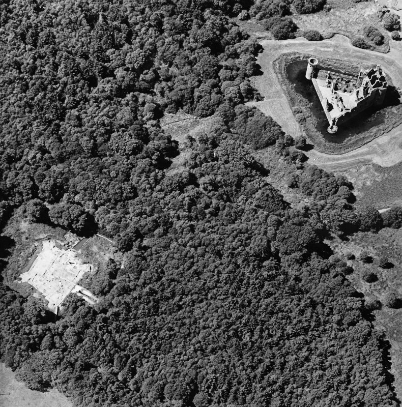 Oblique aerial view centred on the excavation of the old castle with castle adjacent, taken from the E.
