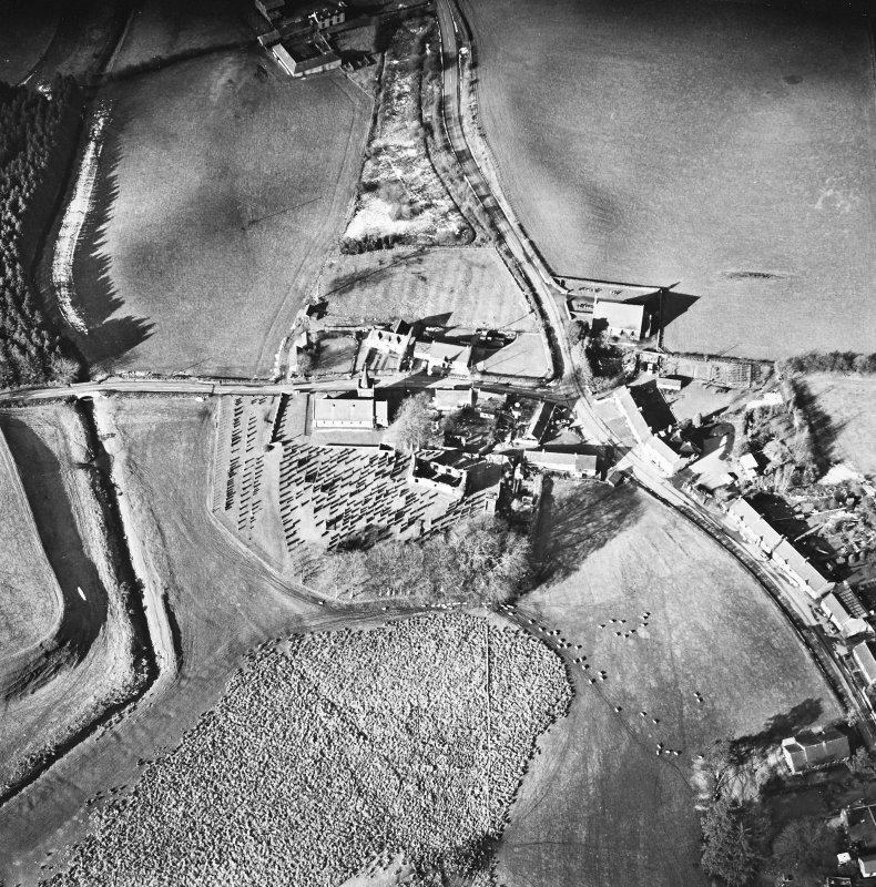 Dalton, oblique aerial view, taken from the SE, centred on the old parish church and the parish church.  A road bridge is visible in the centre left hand side of the photograph.