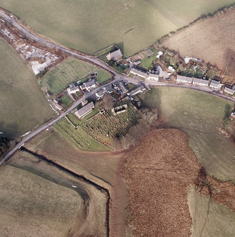 Dalton, oblique aerial view, taken from the SSW, centred on the old parish church and the parish church.  A road bridge is visible in the bottom left hand corner of the photograph.