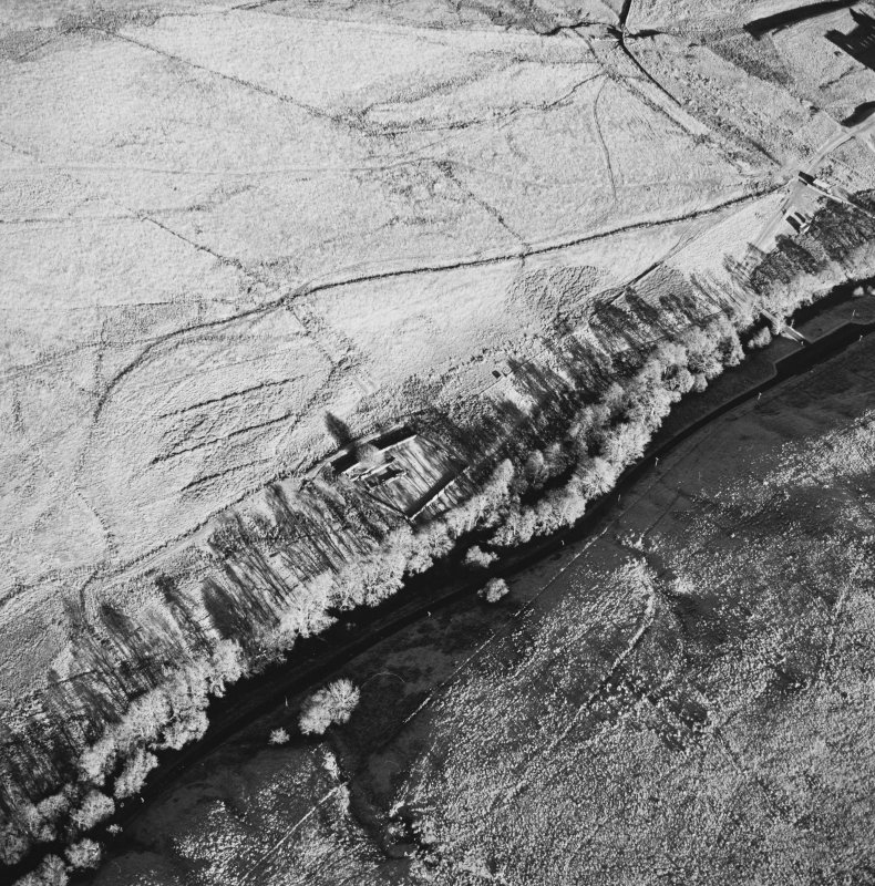 Oblique aerial view of Hermitage centred on the remains of a chapel, boundary dyke and moated site, taken from the SW.