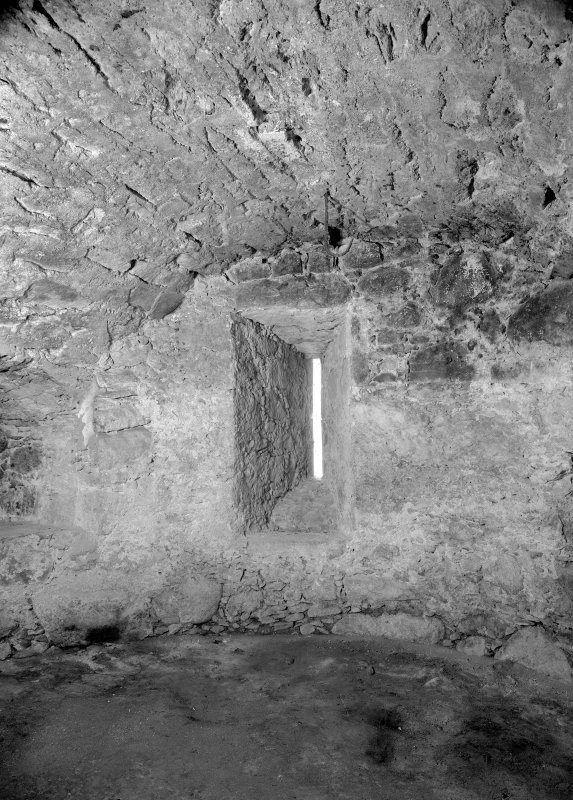 Interior view of Castle Fraser showing detail of shot-hole at base of SE tower.