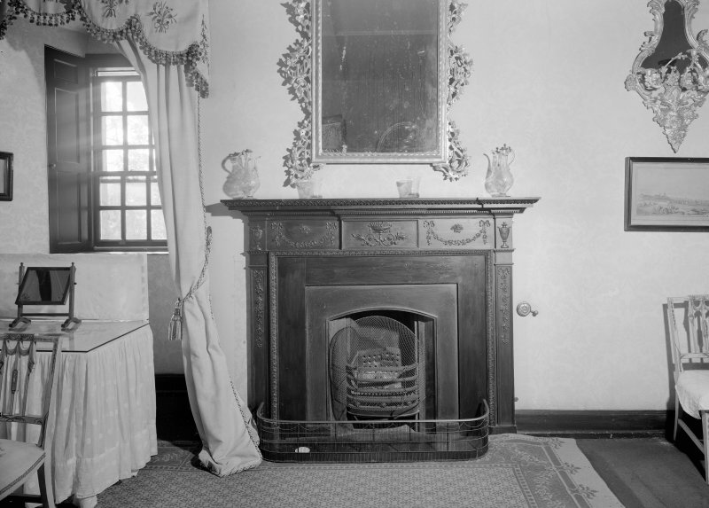 Interior view of Castle Fraser showing view of fireplace in worked room or best bedroom.