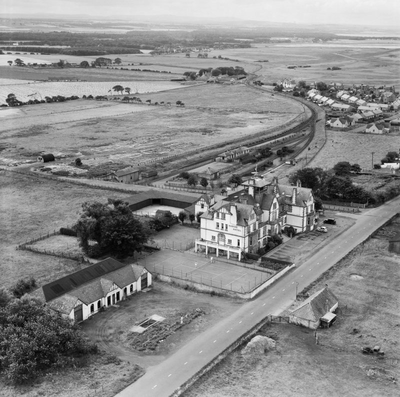 Marine Hotel, Main Street and Gullane Station, Gullane.  Oblique aerial photograph taken facing south-west.  This image has been produced from a crop marked negative.