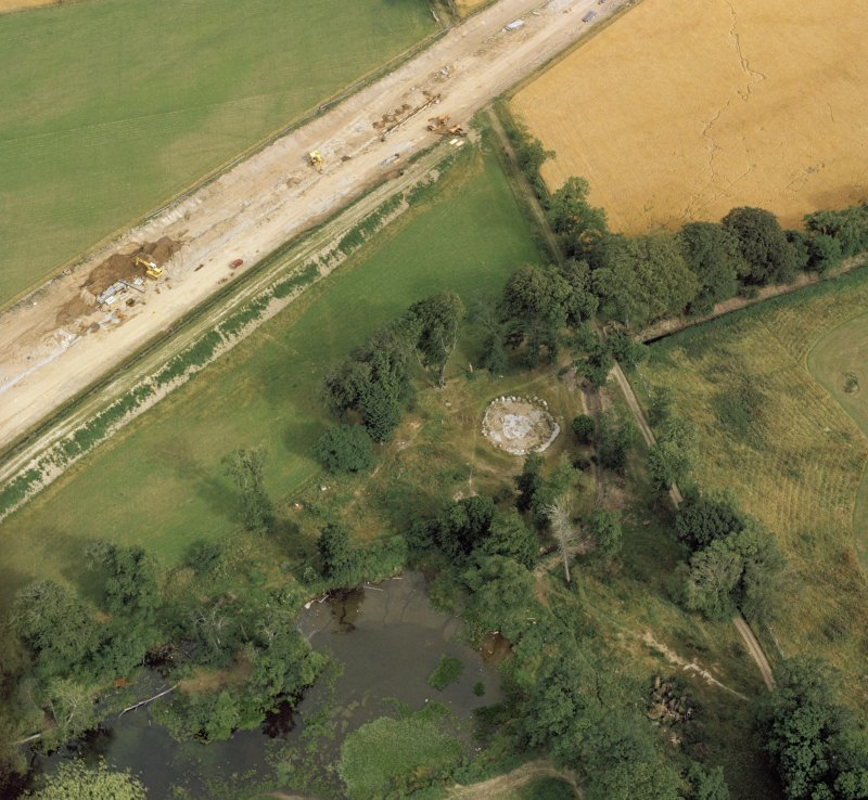 Oblique aerial view of the remains of Stoneyfield cairn.