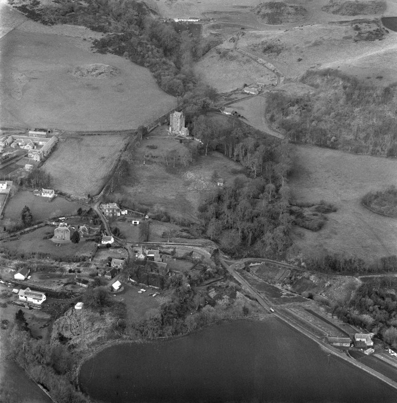 Oblique aerial view of Kinnaird Castle and village and Barton Hill motte under excavation.