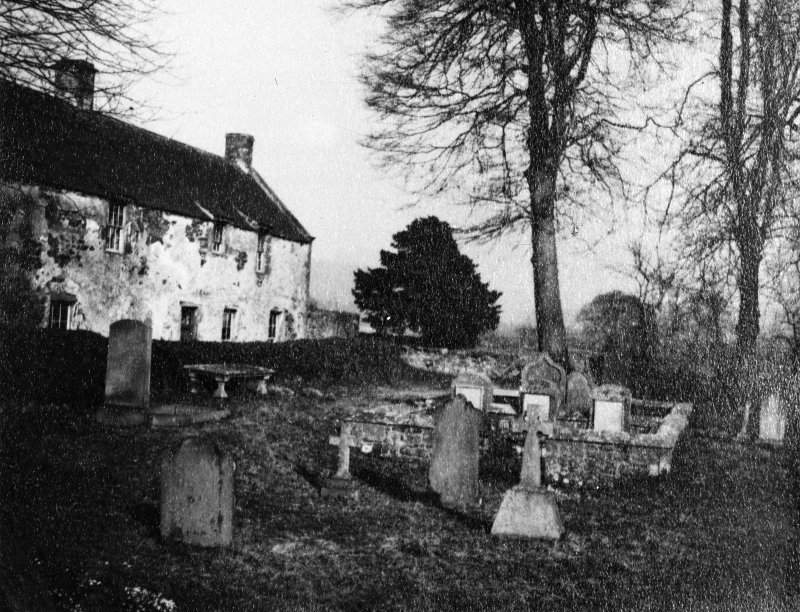View of house and graveyard