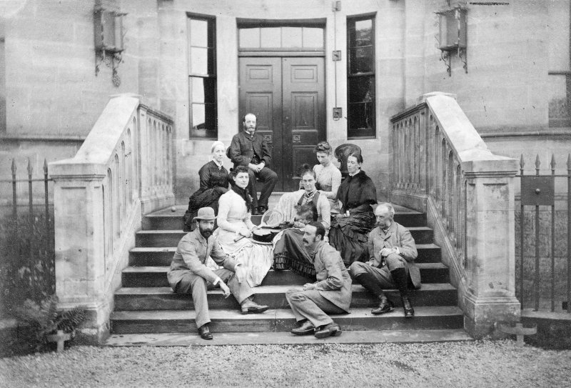 View of family group on entrance steps.