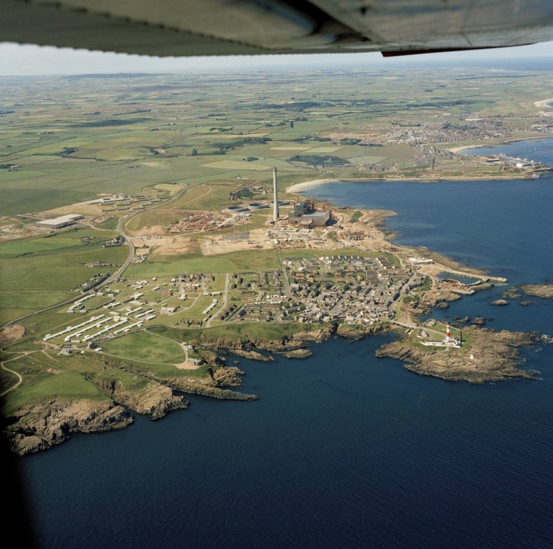 Oblique aerial view of Peterhead Power Station under construction, Boddam village and Buchan Ness lighthouse.