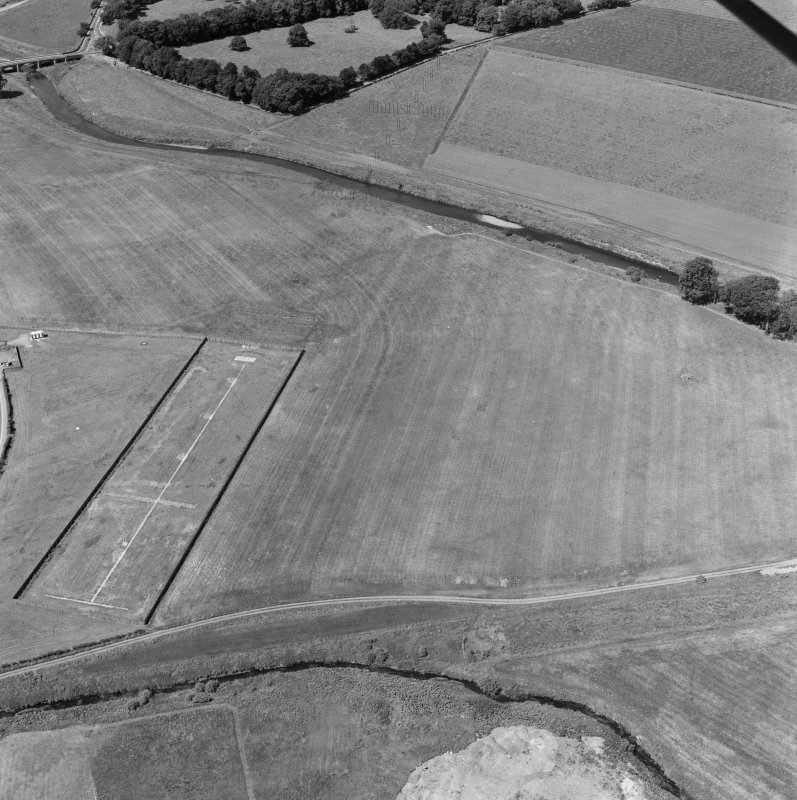Oblique aerial view centred on the site of the Cat Stane.