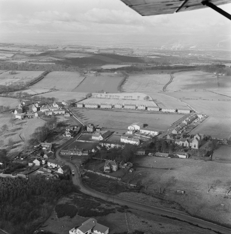 Oblique aerial view centred on Torpichen Preceptory and Parish Church.