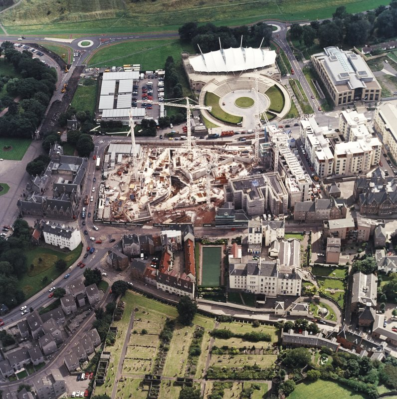 Oblique aerial view centred on the construction of the Scottish Parliament with the exhibition centre adjacent, taken from the NW.