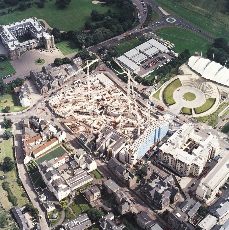 Oblique aerial view centred on the construction of the Scottish Parliament with the exhibition centre adjacent, taken from the WNW.