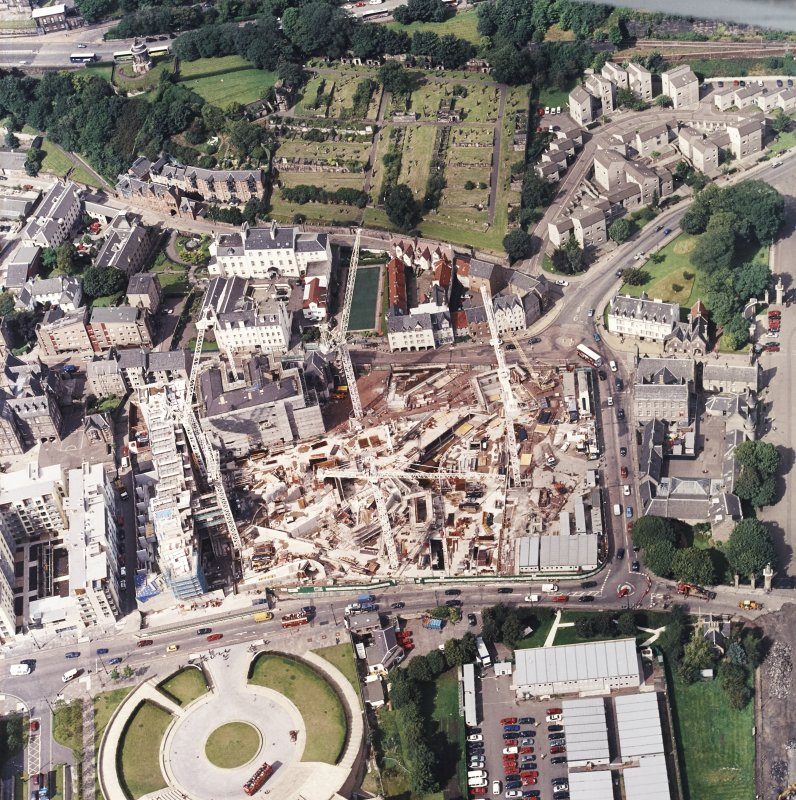Oblique aerial view centred on the construction of the Scottish Parliament, taken from the SE.