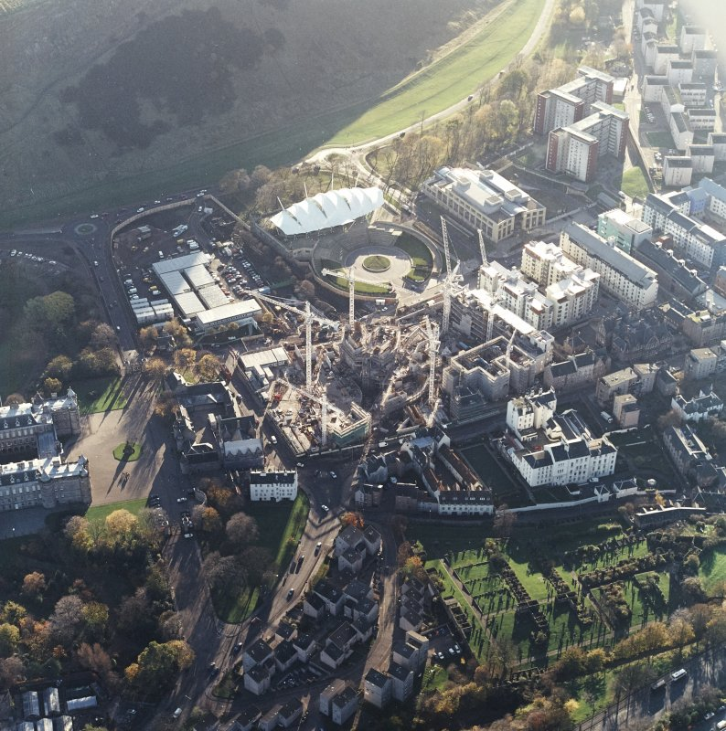 Oblique aerial view centred on the construction of the Scottish Parliament with the exhibition centre adjacent, taken from the N.