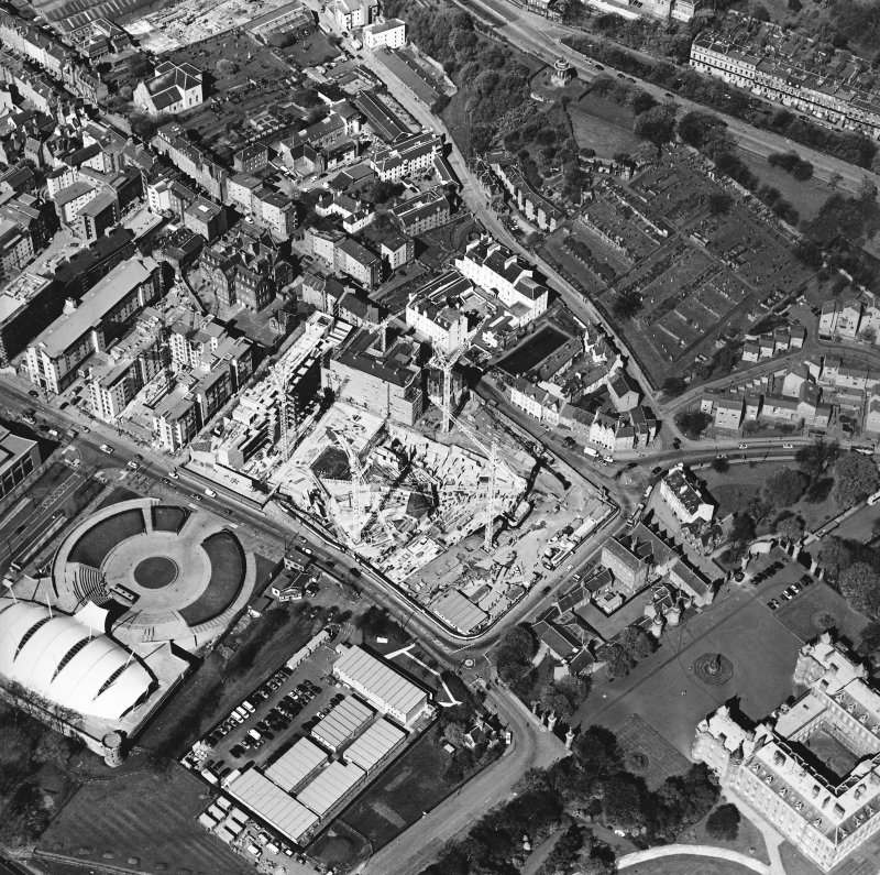 Oblique aerial view centred on the construction of the Scottish Parliament with the exhibition centre adjacent, taken from the SE.