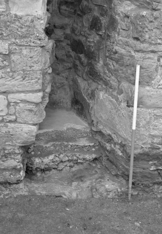 Falkland Palace Excavations Frame 25 - Trench 2: blocked fireplace after removal of concrete - from east