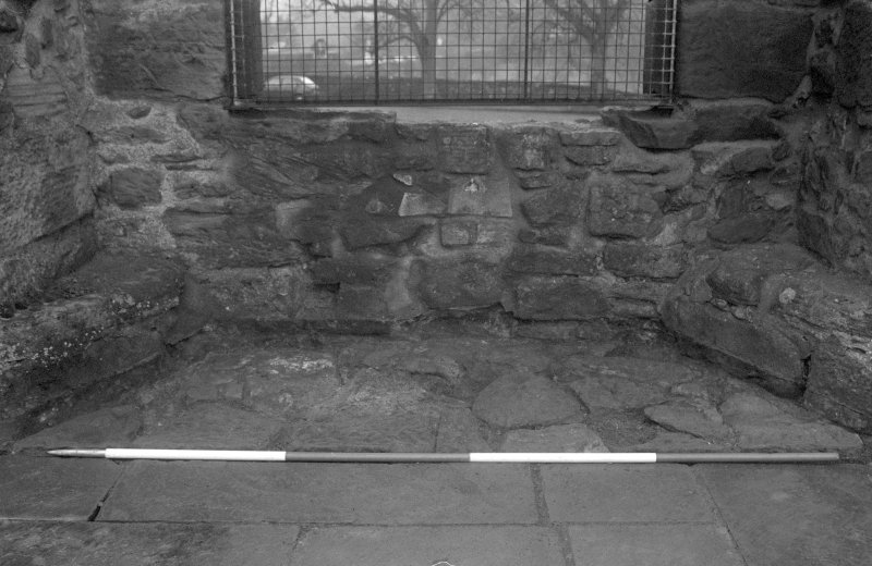 Falkland Palace Excavations Frame 18 - Flagstones in recess of third window from south end of east range after removal of concrete from first floor level - from east