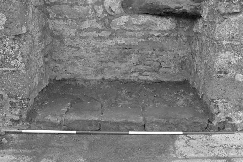 Falkland Palace Excavations Frame 24 - Flagstones in recess of seventh window from south end of east range after removal of concrete from first floor level - from east