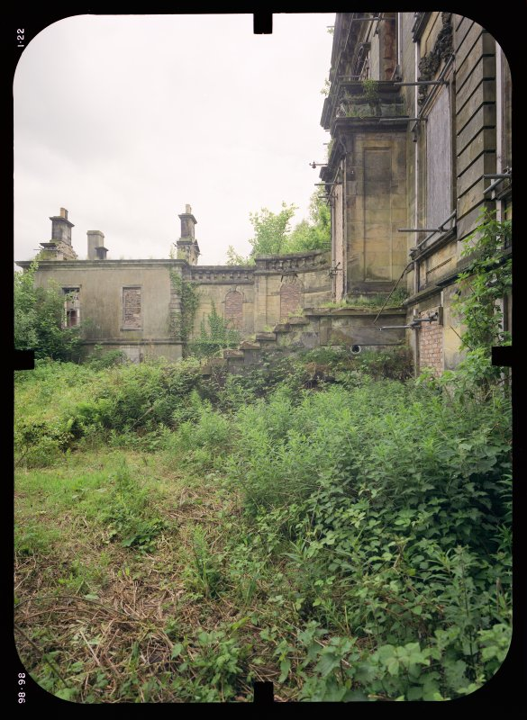 View from NW showing remains of front steps, quadrant screen wall and pavilion, Mavisbank House.