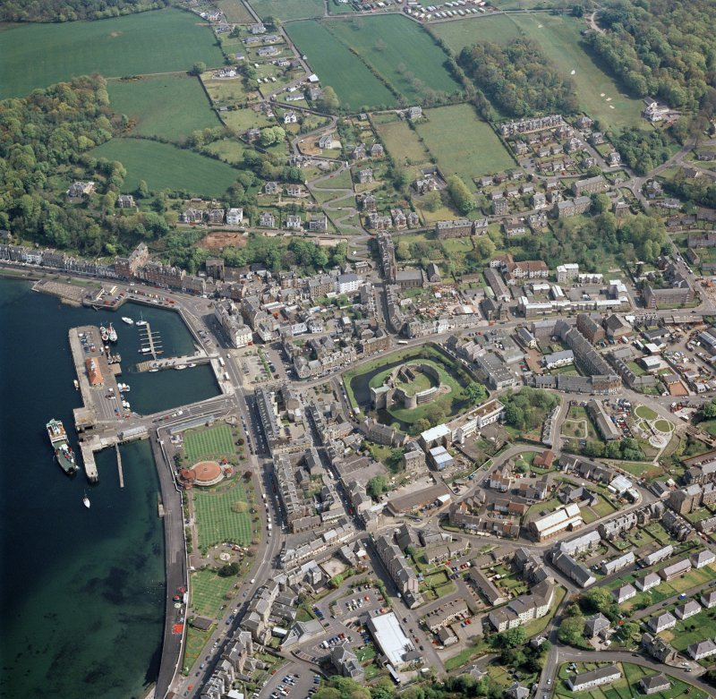 General oblique aerial view of Rothesay centred on the remains of the castle and chapel, with the winter gardens and pier adjacent taken from the W - image supersedes SC1683051