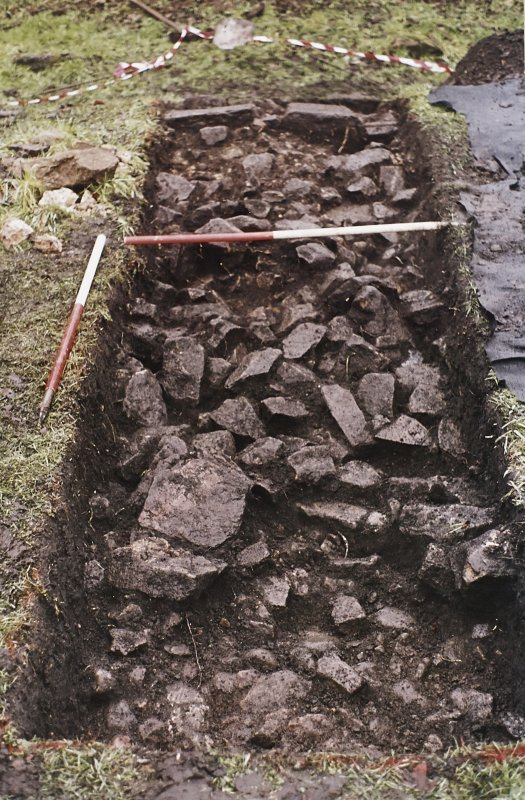 Cobbles, rubble and wall in Trench 5, from the E.