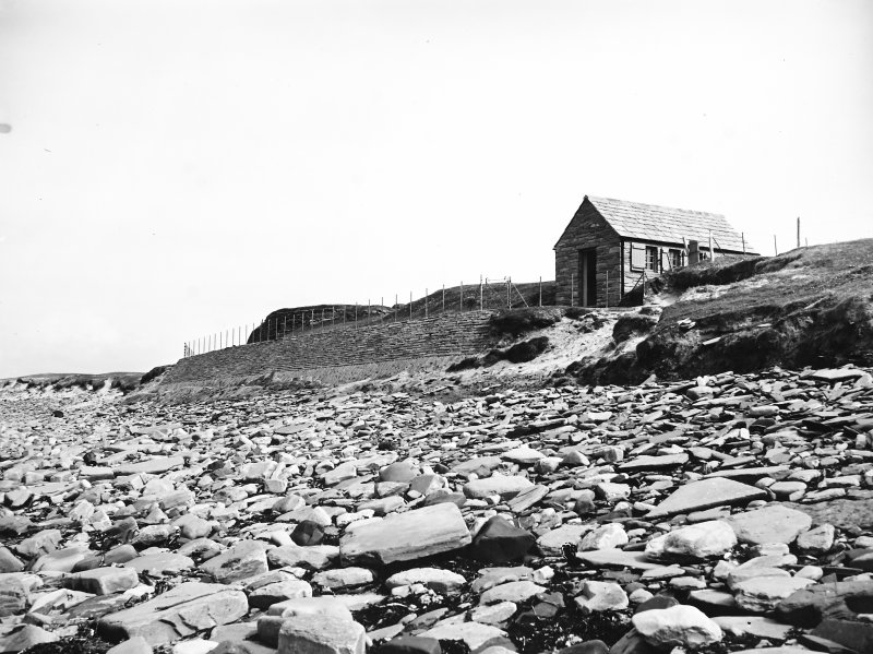 View of sea wall and visitor centre from beach.