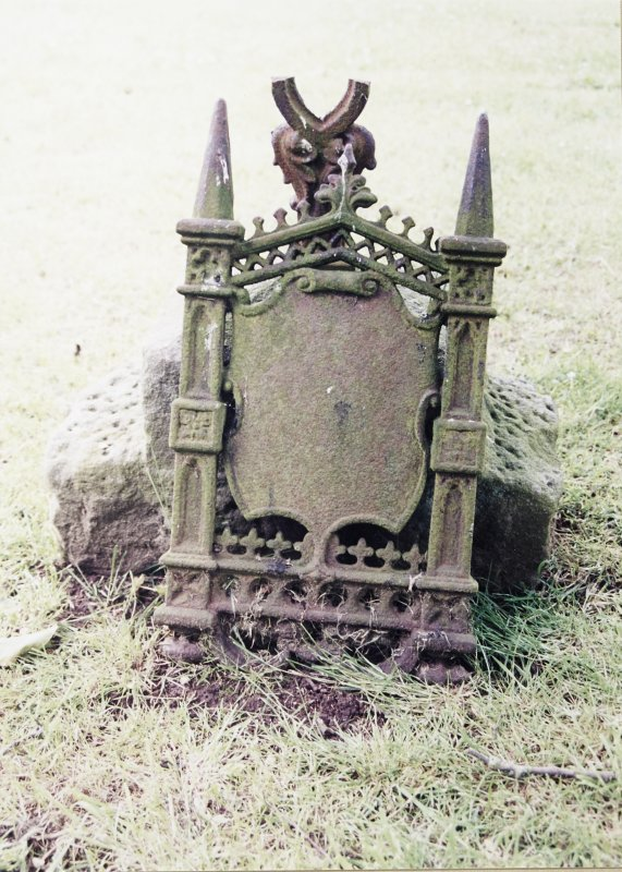 Detail of cast iron headstone.