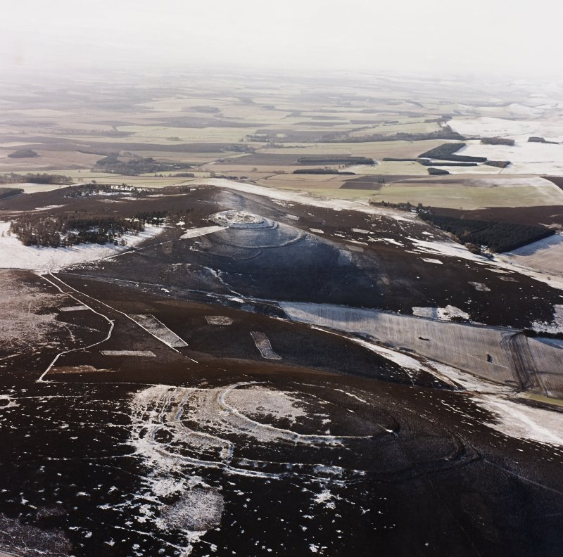 Oblique aerial view of Brown Caterthun centred on the remains of a fort with the remains of White Caterthun fort in the background, taken from the NE.