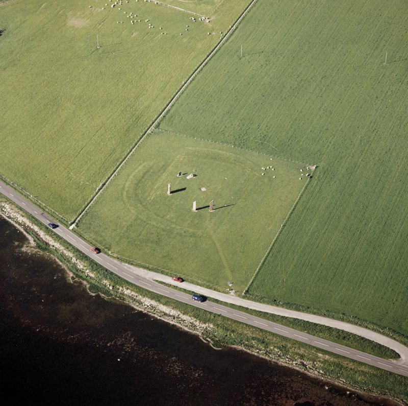 Oblique aerial view of Orkney, Stones of Stenness, henge and standing stones, taken from the SW.