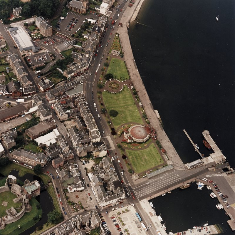 Oblique aerial view of Rothesay centred on the winter gardens, taken from the ESE.