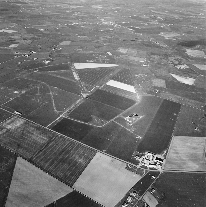 Aerial view of Orkney, Sandwick, taken from the SW, Skeabrae airfield, runways, perimeter track and bomb store.