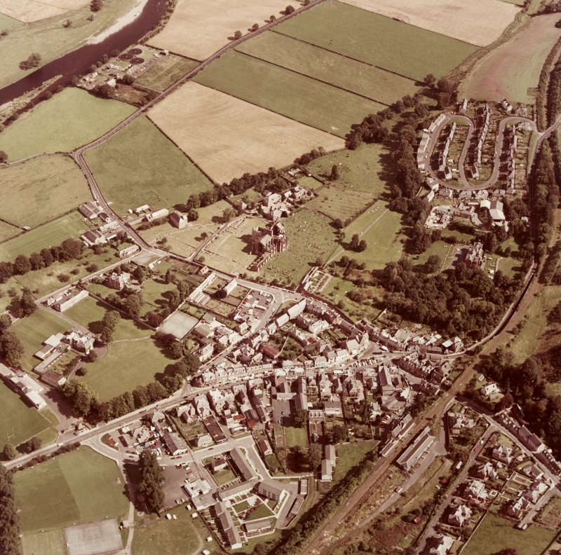 Oblique aerial view centred on abbey from WSW.